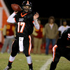 St. Charles East quarterback Jimmy Mitchell passes the ball during their home game against St. Charles East Friday night. (Sandy Bressner photo)