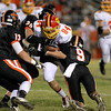 Ben Bennington of Batavia (84) is taken down by Mike Candre (20) and Andrew Badowski (9) of St. Charles East during their game at East Friday night. (Sandy Bressner photo)
