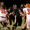 St. Charles East's Erik Anderson (21) runs with the ball during their home game against Batavia Friday night. (Sandy Bressner photo)