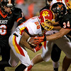 Batavia's Anthony Scaccia runs with the ball during their game at St. Charles East Friday night. (Sandy Bressner photo)