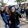 (Right to left) St. Charles North juniors Sierra Hursey, Jennifer Symon and Alyssa Senci watch as the school's homecoming parade travels easton Illinois Street Friday afternoon. (Sandy Bressner photo)