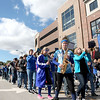The St. Charles North marching band plays the school song while traveling east on Illinois Street during their homecoming parade Friday afternoon. (Sandy Bressner photo)