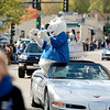Polaris, the St. Charles North mascot, rides atop a convertible while traveling east on Illinois Street during their homecoming parade Friday afternoon. (Sandy Bressner photo)