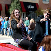 St. Charles North homecoming royalty Alix Scherer and Kevin Leavy wavie to friends during the school's homecoming parade Friday afternoon.  (Sandy Bressner photo)