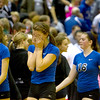 Alex Stone (center) of St. Charles North buries her head in her hands following their 23-25, 19-25 IHSA Class 4A Larkin Sectional semifinal loss against Glenbard West.