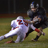 St. Charles North running back George Edlund is taken down by South Elgin's Jonathan Ortega during their game Friday Oct. 19 in St. Charles.<br /> Staff photo by Mark Busch