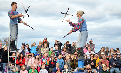 Monica Maschak - mmaschak@shawmedia.com Nick and Eric Budabi entertain a crowd with a juggling performance at the Trail of History at Glacial Park on Saturday.
