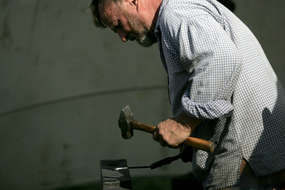 Monica Maschak - mmaschak@shawmedia.com A volunteer blacksmith beats on hot iron with a hammer.  Attendees witnessed what life was like in the Northwest Territory from 1670 to 1850.