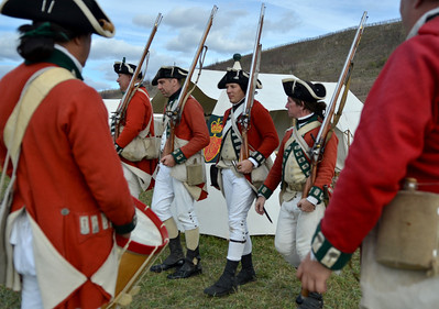 Monica Maschak - mmaschak@shawmedia.com The 55th Regiment of foot lines up in preperation to march as part of a re-enactment during the Trial of History at Glacial Park on Saturday.