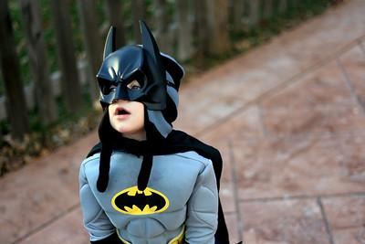Sarah Nader - snader@shawmedia.com Dressed as Batman Griffin Dahlin, 2, of Barrington trick or treats around Algonquin on Wednesday, October 31, 2012.