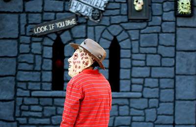 Sarah Nader - snader@shawmedia.com Dressed as Freddy Krueger Dominick Poremba, 8, of Algonquin checks out the decorations at a house while trick or treating in Algonquin on Wednesday, October 31, 2012.