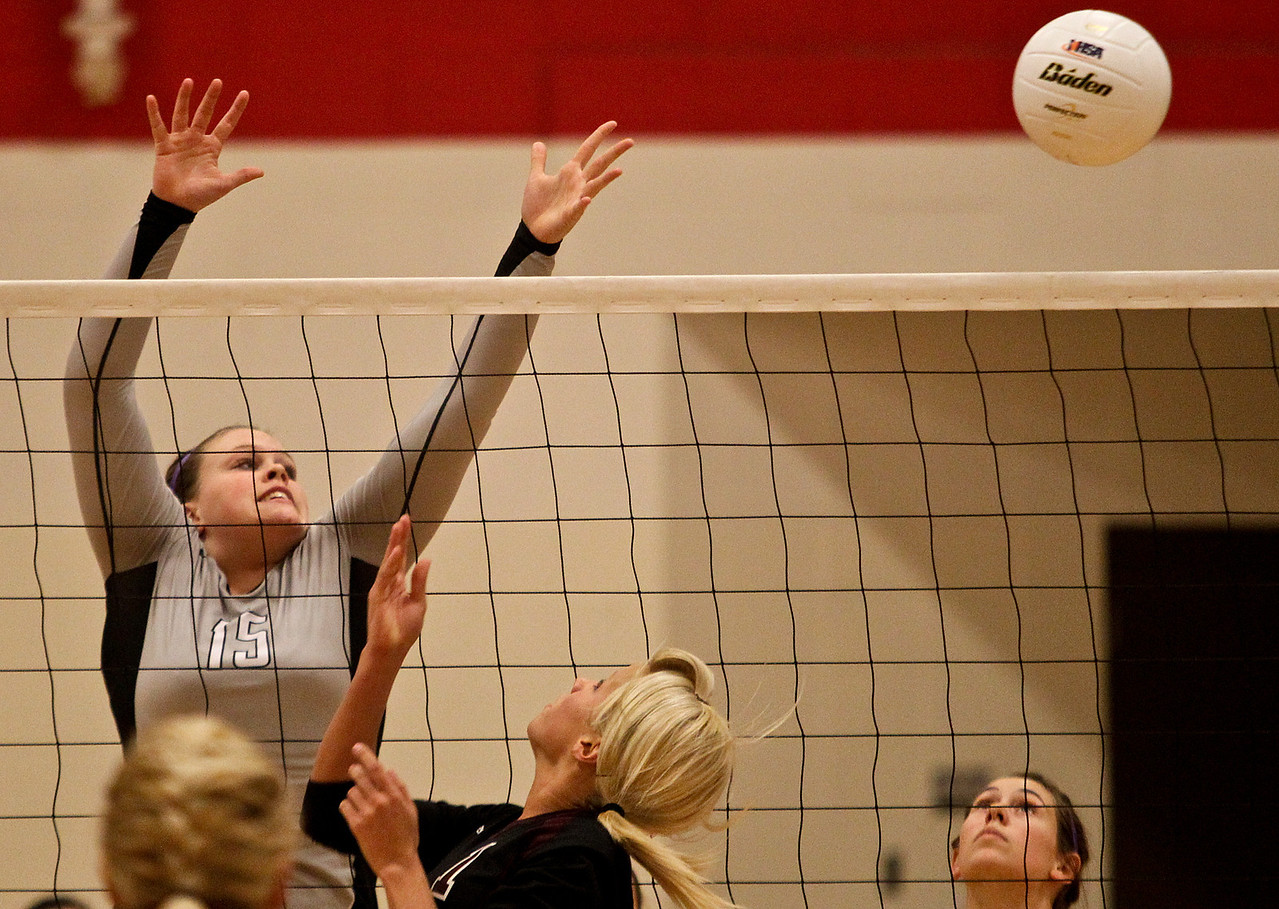 Josh Peckler - Jpeckler@shawmedia.com Kaneland's Lauren Banbury (15) attempts to block a tip by Richmond-Burton setter Kara Russell during the second set at Marian-Central High School Tuesday, October 30, 2012. Richmond-Burton won the match in two sets to advance to the sectional final match.
