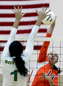 Sarah Nader - snader@shawmedia.com DeKalb's Courtney Wagner (right) hits the ball over during Tuesday's Class 4A Jacobs Sectional volleyball tournament against Boylan in Algonquin on October 30,2012.