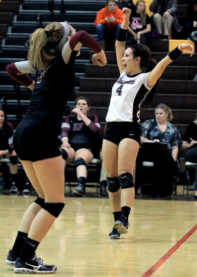 Sarah Nader - snader@shawmedia.com Prairie Ridge's Paige Dacanay (right) celebrates a point during Tuesday's Class 4A Jacobs Sectional volleyball tournament against Warren in Algonquin on October 30,2012. Prairie Ridge's won, 2-1.