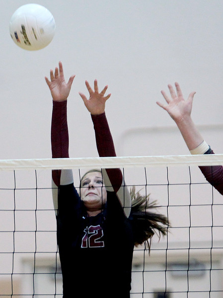 Sarah Nader - snader@shawmedia.com Prairie Ridge's Mackenzie Humm jumps to block the ball during Tuesday's Class 4A Jacobs Sectional volleyball tournament against Warren in Algonquin on October 30,2012. Prairie Ridge's won, 2-1.