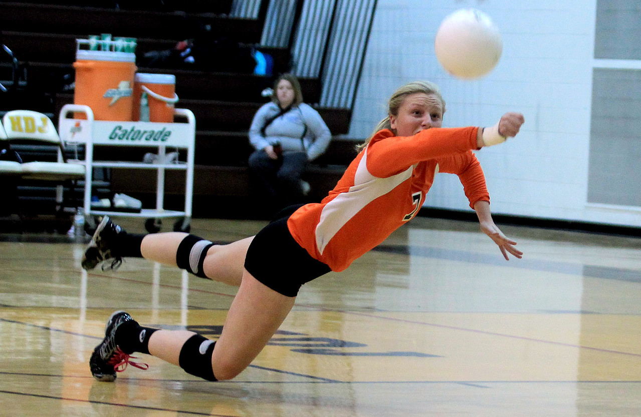Sarah Nader - snader@shawmedia.com DeKalb's Abby Hickey dives for the ball during Tuesday's Class 4A Jacobs Sectional volleyball tournament against Boylan in Algonquin on October 30,2012.