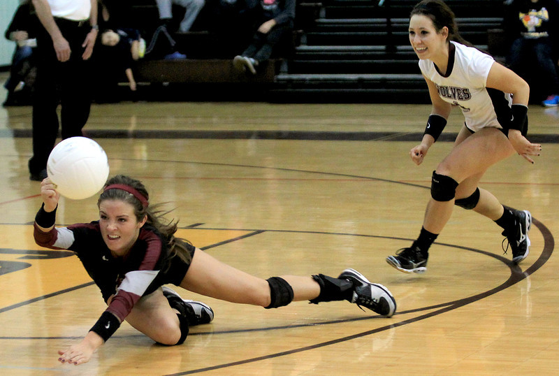 Sarah Nader - snader@shawmedia.com Prairie Ridge's Nikki Kirchberg dives for the ball during Tuesday's Class 4A Jacobs Sectional volleyball tournament against Warren in Algonquin on October 30,2012. Prairie Ridge's won, 2-1.