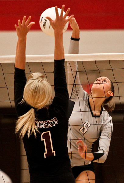 Josh Peckler - Jpeckler@shawmedia.com Kaneland's Lyndi Scholl attempts to hit the ball past Richmond-Burton's Kara Russell during the second set at Marian-Central High School Tuesday, October 30, 2012. Richmond-Burton won the match in two sets to advance to the sectional final match.