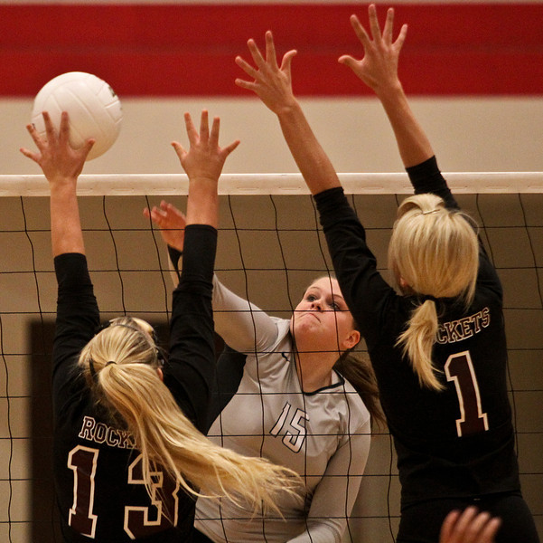Josh Peckler - Jpeckler@shawmedia.com Kaneland's Lauren Banbury (15) hits the ball past Richmond-Burton's Brogan Etten (13) and Kara Russell during the second set at Marian-Central High School Tuesday, October 30, 2012. Richmond-Burton won the match in two sets to advance to the sectional final match.