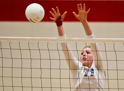 Josh Peckler- Jpeckler@shawmedia.com Marian Central's Hannah Davis (11) goes up to block a ball against Grayslake Central during the first set at Marian Central High School Tuesday, October 30 ,2012.