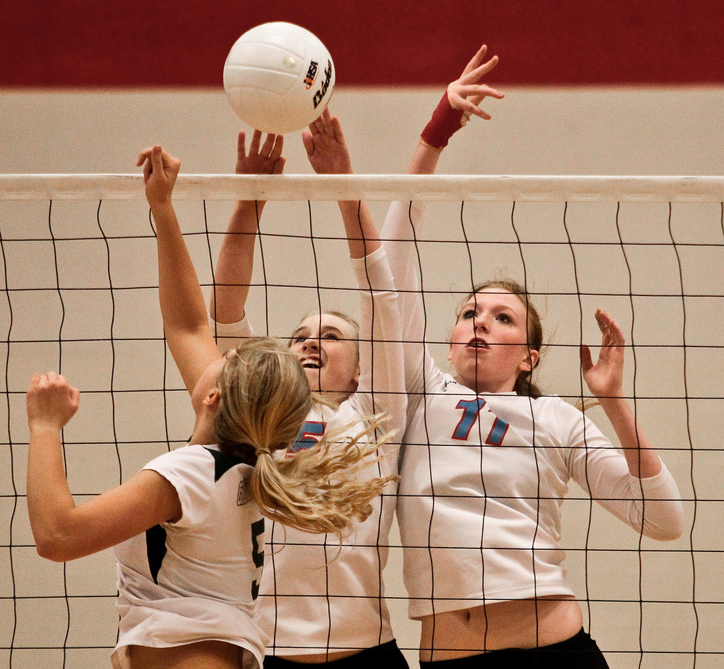 Josh Peckler - Jpeckler@shawmedia.com Marian Central's Hannah Davis (11) and Alex Kaufmann (5) attempt to block a tip by Grayslake Central's Lexi Beckman during a sectional semi-final game at Marian Central High School Tuesday, October 30, 2012.