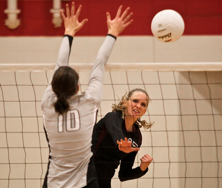 Josh Peckler - Jpeckler@shawmedia.com Richmond-Burton's Ali Frantti hits the ball past Kaneland's Keri Groen during the first set at Marian-Central High School Tuesday, October 30, 2012. Richmond-Burton won the match in two sets to advance to the sectional final match.