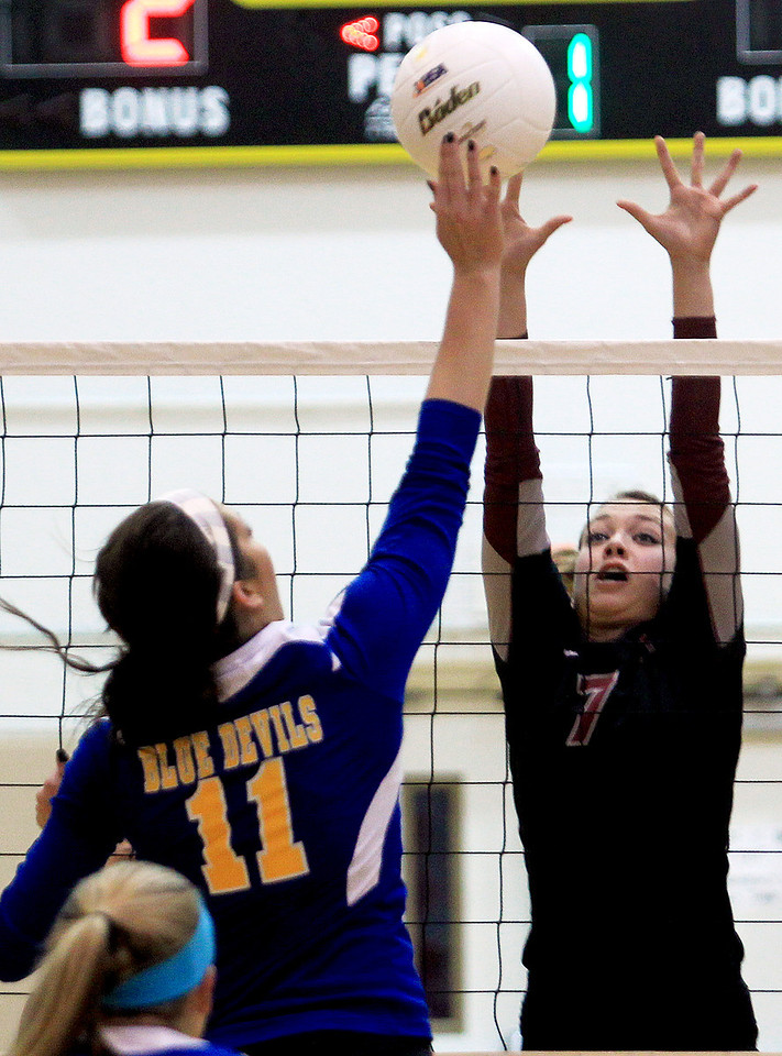 Sarah Nader - snader@shawmedia.com Prairie Ridge's Taylor Otto (right) jumps to block the ball during Tuesday's Class 4A Jacobs Sectional volleyball tournament against Warren in Algonquin on October 30,2012. Prairie Ridge's won, 2-1.