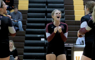 Sarah Nader - snader@shawmedia.com Prairie Ridge's Caitlin Brauneis celebrates a point during Tuesday's Class 4A Jacobs Sectional volleyball tournament against Warren in Algonquin on October 30,2012. Prairie Ridge's won, 2-1.