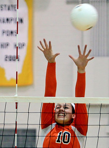 Sarah Nader - snader@shawmedia.com DeKalb's Alexis Hammond jumps to block the ball during Tuesday's Class 4A Jacobs Sectional volleyball tournament against Boylan in Algonquin on October 30,2012.