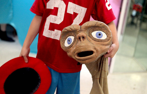 Jack Dixon, 10, of St. Charles tries on his E.T. the Extra-Terrestrial costume at All Dressed Up Costumes in Batavia Thursday. (Sandy Bressner photo)