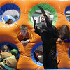 Jeff Krage – For the Kane County Chronicle<br /> Matthew Schweik, 5, of North Aurora jumps in an inflatable as other children climb through holes during Saturday's Halloween Hayday at Stephen Persinger Recreation Center.<br /> Geneva 10/27/12