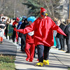 Fourth grade teacher Nancy McCormick, dressed as a cardinal, leads her class in their Halloween costume parade around Lincoln Elementary School in St. Charles Wednesday.(Sandy Bressner photo)