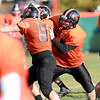 St. Charles East center Ben Smith (right) attempts to block a defender during practice Wednesday afternoon.