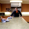 Sugar Grove firefighter candidate Brandon Gudovitz cleans up the station's kitchen following lunch.