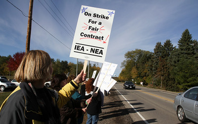 Mike Greene - mgreene@shawmedia.com Kaiti Hart, a teacher in District 46 for 12 years, holds a sign while on strike Friday, October 12, 2012 outside of the Prairie Grove District 46 campus in Prairie Grove. Teachers in the district went on strike Friday morning and are currently in contract negotiations.