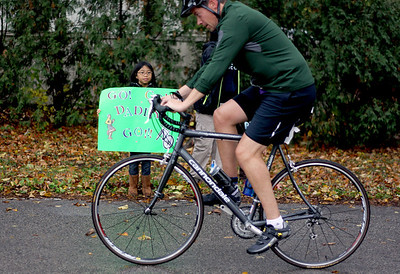 Sarah Nader - snader@shawmedia.com Bianca Jimenez, 7, of Bollingbrook cheers on her dad while he competes in the fourth annual Run and Roll for the Dole in Crystal Lake on Sunday, October 14, 2012. The race featured a 2 mile run through Crystal Lake, 20k bike course and a repeat of the 2 mile to the finish line. All proceeds from the race will benefit Lakeside Legacy Foundation and Historic Dole Mansion.