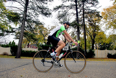 Sarah Nader - snader@shawmedia.com Ken Bolin competes in the fourth annual Run and Roll for the Dole in Crystal Lake on Sunday, October 14, 2012. The race featured a 2 mile run through Crystal Lake, 20k bike course and a repeat of the 2 mile to the finish line. All proceeds from the race will benefit Lakeside Legacy Foundation and Historic Dole Mansion.
