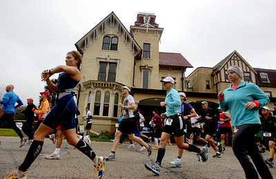 Sarah Nader - snader@shawmedia.com Racers participate in the fourth annual Run and Roll for the Dole in Crystal Lake on Sunday, October 14, 2012. The race featured a 2 mile run through Crystal Lake, 20k bike course and a repeat of the 2 mile to the finish line. All proceeds from the race will benefit Lakeside Legacy Foundation and Historic Dole Mansion.
