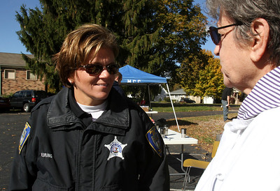 Mike Greene - mgreene@shawmedia.com Cary Police Officer Kathy Eiring speaks with Jean Anderson, of Cary,  during a vehicle safety inspection event Friday, October 12, 2012 at Korean Methodist Church in Cary. Eiring, an Elderly Service Officer, speaks regularly with seniors about potential concerns and suggested Anderson come to the event when speaking at the Cary Senior Center.