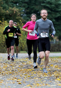 Sarah Nader - snader@shawmedia.com Brice Alt (right) competes in the fourth annual Run and Roll for the Dole in Crystal Lake on Sunday, October 14, 2012. The race featured a 2 mile run through Crystal Lake, 20k bike course and a repeat of the 2 mile to the finish line. All proceeds from the race will benefit Lakeside Legacy Foundation and Historic Dole Mansion.