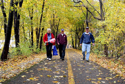 Sarah Nader - snader@shawmedia.com Katy Spooner (left) of Huntley, Ken Spooner of Huntley and Dave Clark of Lake in the Hills participate in the Cardunal Crop Hunger Walk in Algonquin on Sunday, October 14, 2012. The 2.2 or 3 mile walk was held to help children and families worldwide and in  the U.S. to have food for today, while building for a better tomorrow.