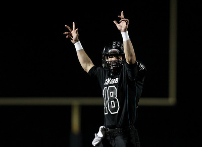 Josh Peckler - Jpeckler@shawmedia.com Woodstock North quarterback Brian Loftin puts his hands up in celebration after Woodstock North scored the first touchdown of the game against Grayslake North during the first quarter at Woodstock North High School Friday, October 19, 2012.