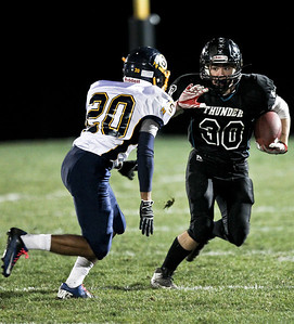 Josh Peckler - Jpeckler@shawmedia.com Woodstock North's Grant Wade (30) prepares to stiff arm Sterling's Temo Barron during a run in the first quarter at Woodstock North Saturday, October 27, 2012. Woodstock North defeated visting Sterling 68-20 during their IHSA Class 5A first round playoff game.