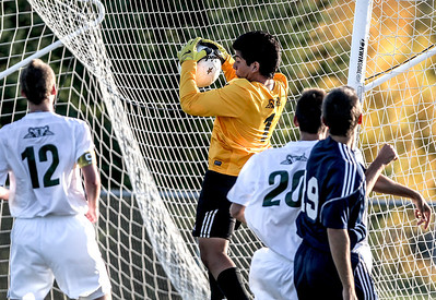 Sarah Nader- snader@shawmedia.com Crystal Lake South's goalie Gus Alvarez block a goal during the first half of Tuesday's soccer match in Crystal Lake October 1, 2013.