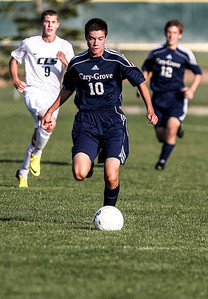 Sarah Nader- snader@shawmedia.com Cary-Grove's Dale Opasser brings the ball down field during the first half of Tuesday's soccer match against Crystal Lake South in Crystal Lake October 1, 2013.