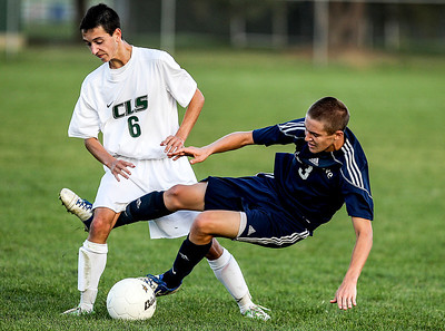 Sarah Nader- snader@shawmedia.com Crystal Lake South's David Tagatz (left) tries to keep the ball from Cary-Grove's Michael Arenberg during the second half of Tuesday's soccer match in Crystal Lake October 1, 2013.