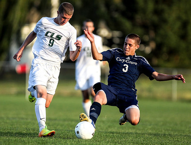 Sarah Nader- snader@shawmedia.com Crystal Lake South's Matt Tobolt (left) if defended by Cary-Grove's Michael Arenberg during the second half of Tuesday's soccer match in Crystal Lake October 1, 2013.