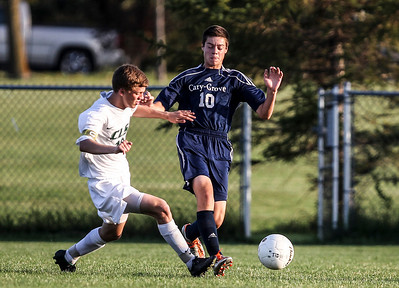 Sarah Nader- snader@shawmedia.com Crystal Lake South's Charlie Ruff (left) and Cary-Grove's Dale Opasser run after the ball during the first half of Tuesday's soccer match in Crystal Lake October 1, 2013.