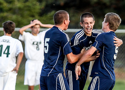 Sarah Nader- snader@shawmedia.com Cary-Grove's  Michael Arenberg (center) celebrates with his teammates after scoring a goal during the second half of Tuesday's soccer match against Crystal Lake South October 1, 2013.