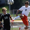 Jeff Krage – For Shaw Media<br /> St. Charles East's Jordon Moore kicks the ball away from Streamwood's Nestor Ascencio during Saturday's game at St. Charles East High School.<br /> St. Charles 9/28/13